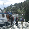 Visitors disembarking a tour boat in Bergen, Norway.