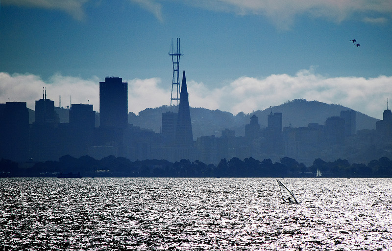 Sailboarder and San Francisco skyline.  Those are 2 of the Blue Angels flying over.