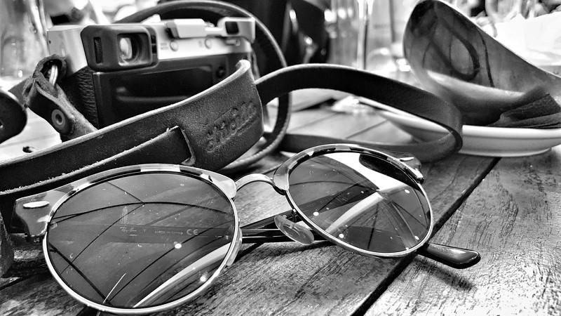 Valerie's trademark sunglasses and camera.