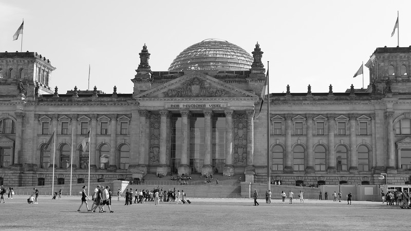 The Reichstag Building is where the German Parliament meets.  The glass dome represents transparency in government.