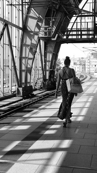 Going about her day in Berlin (at the Alexanderplatz train station).