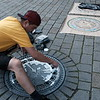This artist painted manhole covers and made t-shirts out of the prints (of course, I bought one).