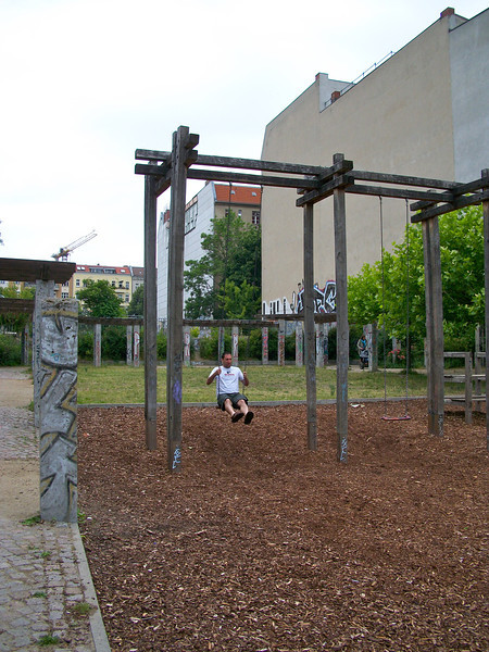 Brian on the adult-sized swing set in Prenzlauerberg.