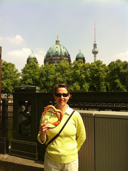 Ann with giant pretzel, before our climb up Berliner Dom