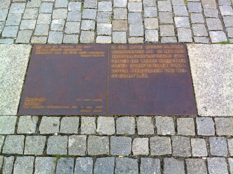 "Plaque at Bebelplatz, where the book burning of May 1933 took place.  The quote in the upper left is from Heinrich Heine in 1820: ""the burning is just a prologue: where they burn books, they ultimately burn people"" (His books were among those burned)"