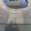 Interesting puddle reflecting the Bauhaus Archive