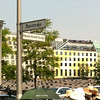 Stellae of the Jewish memorial visible in the foreground (on Hannah Arendt Strasse)