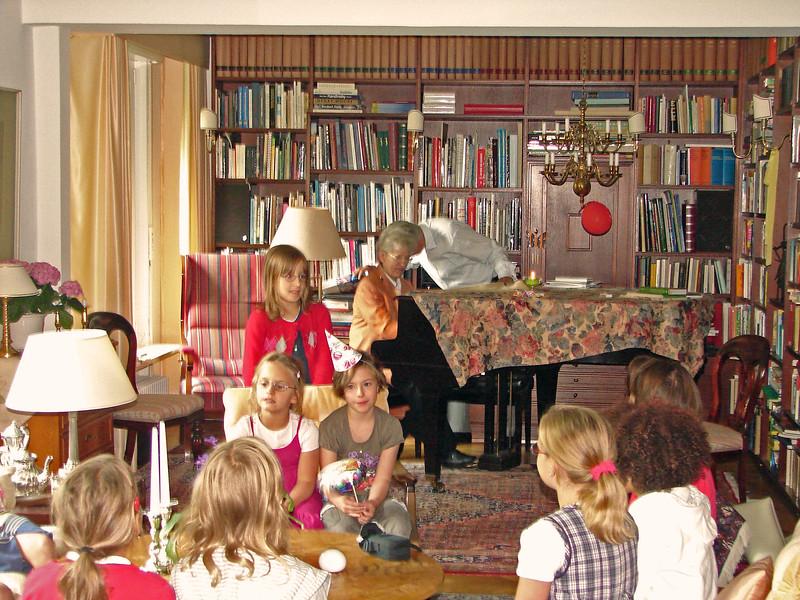 Uli's wife entertains grandchildren at birthday party