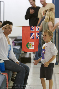 Mother and son admire flag of Bermuda