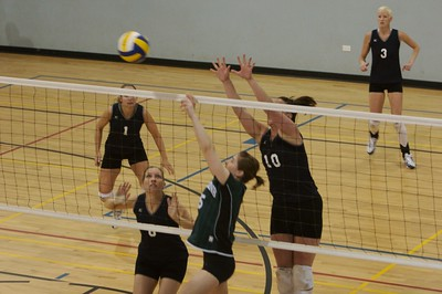 Kelly Ross-10 of the Bermuda National Team jumps with the Canadian setter