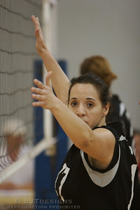 Marina Ciotti of Downstate VBC glances over while ready at the net