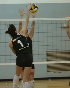 Erica West -1 of Livingston Orange Crush gets one by the Bermuda block