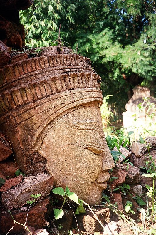 A ruined bust at Indein, a ruined temple complex with hundreds of stupas on a hill overlooking Inle Lake, Burma.