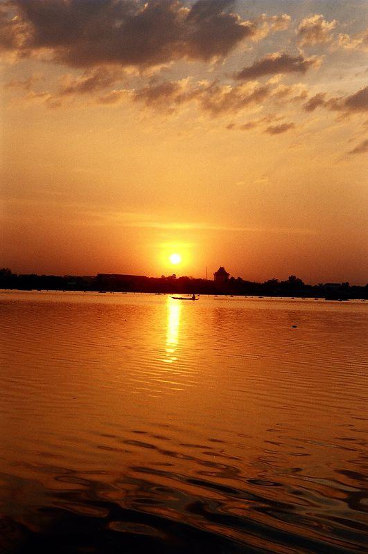 The sunset over Boeng Kak lake from lakeside Guesthouse, Phnom Phen.
