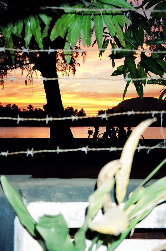 Sunset from inside the Garden Bar, Kampot.  This was the only bar in Kampot but it was very chill despite the barbed wire (which all the guesthouses also had).