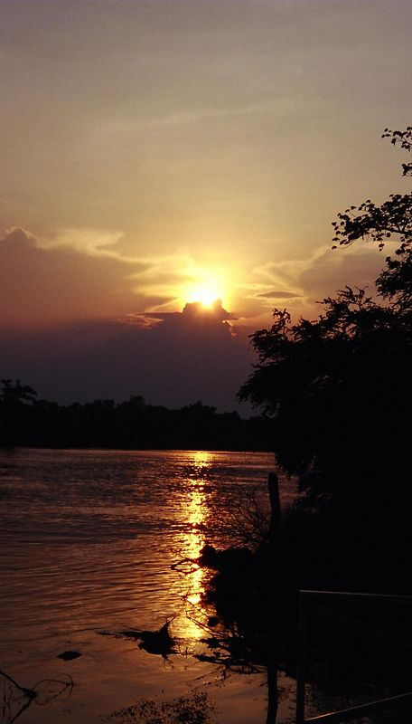 Sunset over teh river Kwai (with bridge int eh background), Kanchanaburi, Thailand.