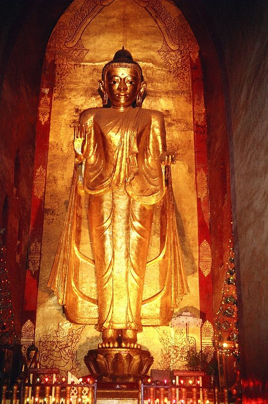 Gold statue of Buddha inside one of Bagans many temples, Burma.
