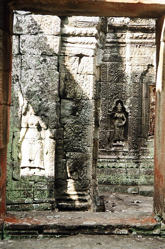 Carved reliefs inside one of the smaller temples, Angkor.