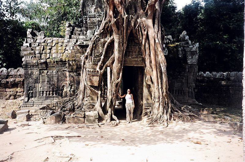 Tree grown over temple gateway (and me).  Angkor.