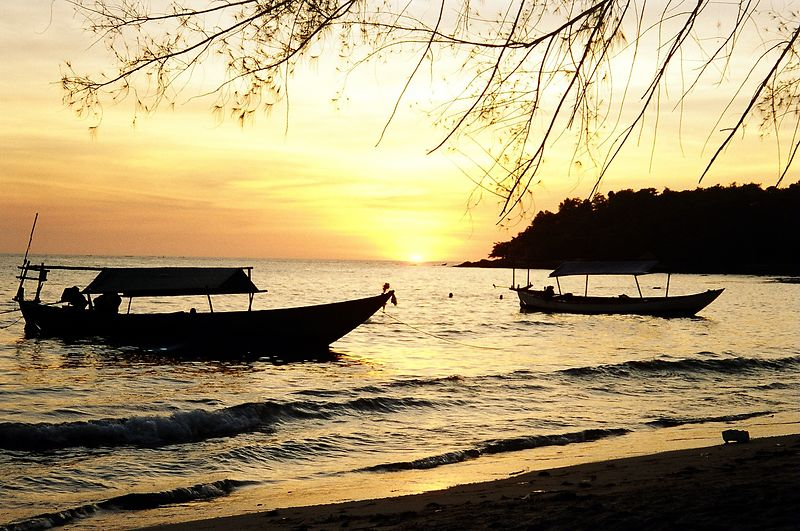Boats off the beach at sunset, Serendipity beach, Sianoukville, Cambodia.