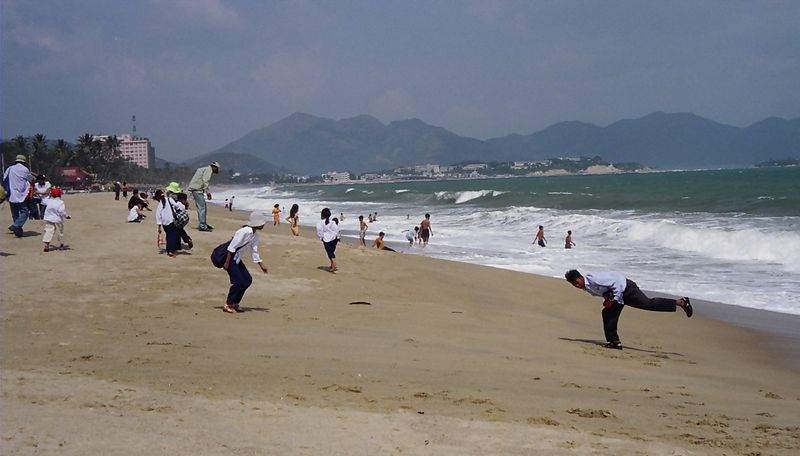 Locals enjoying the beach over the Tet holidays, Nha Trang, Vietnam.