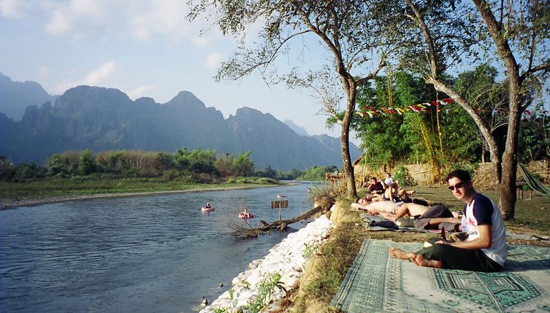 People tubing and chilling in Vang Vieng, Laos