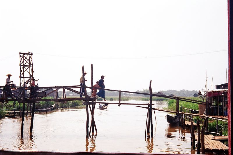 Locals crossing bridge from market, Inle Lake, Burma.