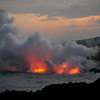 Lava entering the sea, near Kupapau Point.  Volcano National Park.