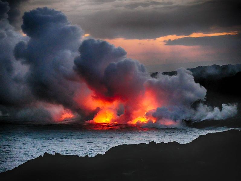 Lava entering the sea, near Kupapau Point.  Volcano National Park.