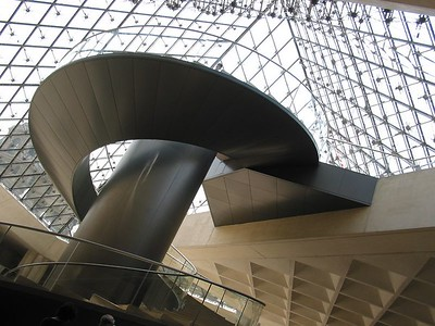 The staircase with an elevator in the center at the Louvre - where's Waldo?