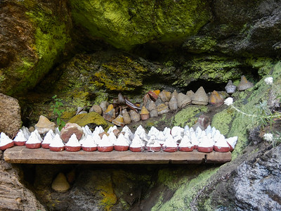 Mini Chortens (Tsa-Tsa) tucked in the rocks.