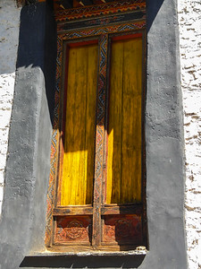 Bright saffron yellow door.