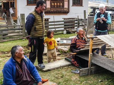The grandmother weaving.
