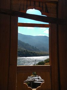 Carved wood frame window. Integrated into the rammed earth construction. Sankosh River - Punakha, Bhutan.