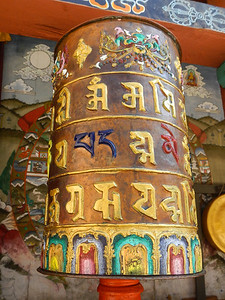 Prayer wheel with circle of life behind.