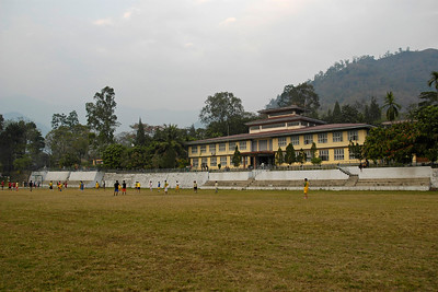 Football and other sports being played on the grounds in front of the main building of National Institute Education (NIE), Samtse, Bhutan