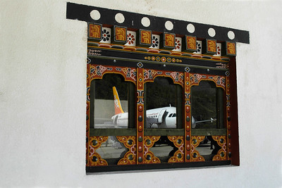 Paro Airport with Druk Air reflecting in the window