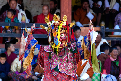 "The Mask Dance in Paro, Bhutan is so popular that getting a room to stay can be really hard and people book months in advance as the festival draws a lot of tourists.  The Paro Tshechu festival honors Guru Padmasambhava, ""one who was born from a lotus flower."" This Indian saint contributed enormously to the diffusion of Tantric Buddhism in the Himalayan regions of Tibet, Nepal, Bhutan etc. The biography of Guru is highlighted by 12 episodes of the model of the Buddha Shakyamuni's life. Each episode is commemorated around the year on the 10th day of the month by ""the Tshechu.""  During Tshechu, the dances are performed by monks as well as by laymen. The Tshechu is a religious festival and by attending it, it is believed one gains merits. It is also a yearly social gathering where the people, dressed in all their finery, come together to rejoice."