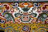 A typical building decoration. The dragon is Bhutan's National Symbol.