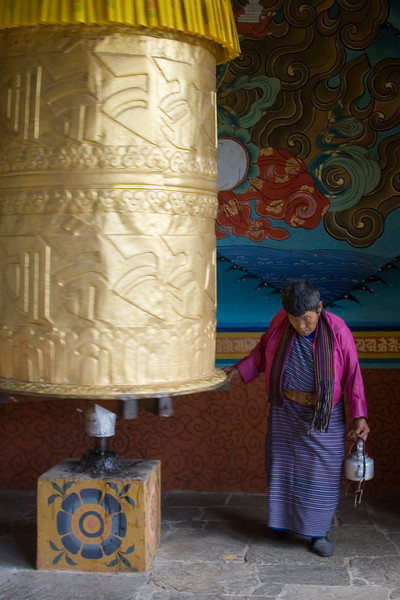 Punakha Dzong. Woman with Prayer Wheel
