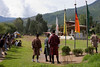 Archery is Bhutan's National Sport. The Target is in the Tiny Group of People Above the Left Shoulder of the Leftmost Archer.