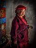 2018-02-15_Bhutan_Jambay_Lhakhang_womanPrayerWheel-1811