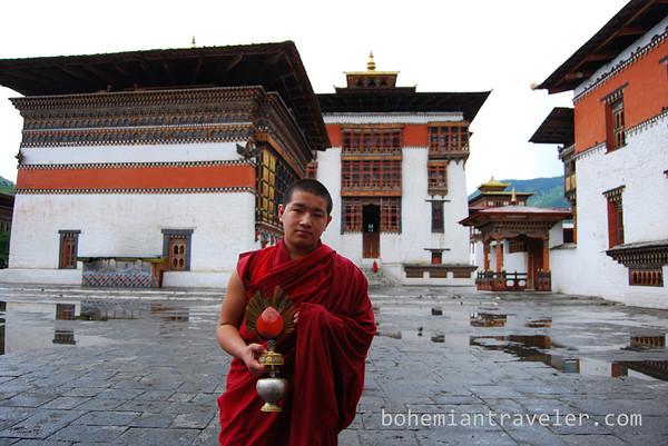 A monk inside Thimphu's Tashichho Dzong (Bhutan).