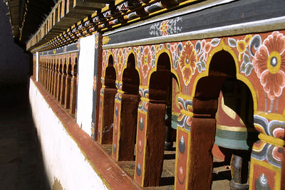Bhutanese dzong architecture reached its zenith in the 1600s under the leadership of the great lama Shabdrung Ngawang Namgyal. The Shabdrung relied on visions and omens to site each of the dzongs. Modern military strategists would observe that the dzongs are well-sited with regard to their function as defensive fortresses. Wangdue Phodrang dzong, for instance, is set upon a spur overlooking the confluence of the Mo Chhu and Pho Chhu rivers thus blocking any attacks by southern invaders who attempted to use a river route to bypass the trackless slopes of the middle Himalayas in attacking central Bhutan. Drukgyel dzong at the head of Paro valley guards the traditional Tibetan invasion path over the passes of the high Himalayas.
