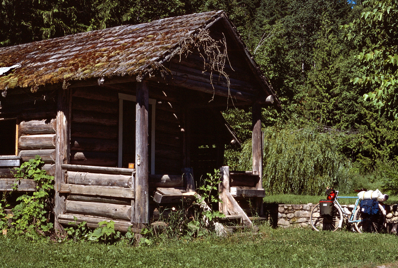We stop cycling to explore a rustic log building beside the road - Highway 20 in the North Cascades of Washington State.