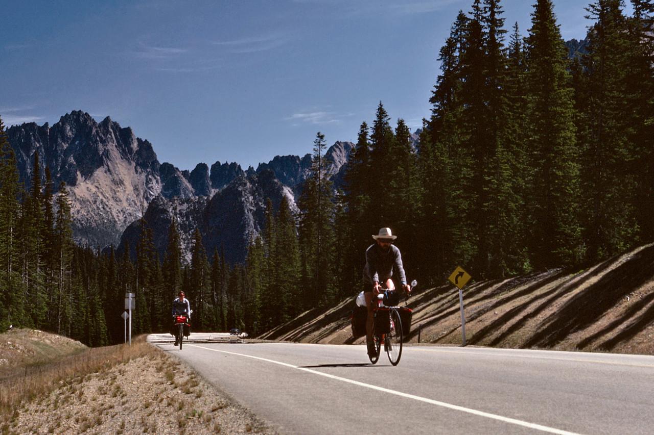 Rita and Gary coasting west down Washington Highway 20 after crossing Washington Pass.