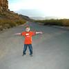 Blake on Old Maverick Road, with the walls of Santa Elena 10 miles behind