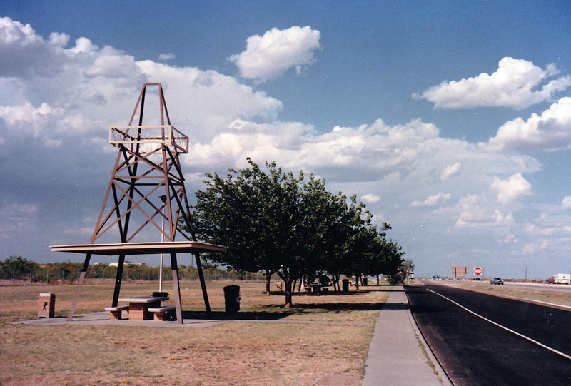 MIDLAND/ODESSA REST STOP  Yep, we're now in oil country, all right, as was evidenced by the truck stop earlier and the derrick-shaped shade structures here. I've always loved this place, except for the water in the fountains. Do NOT drink the water! <i>GACKKK!!!</i>