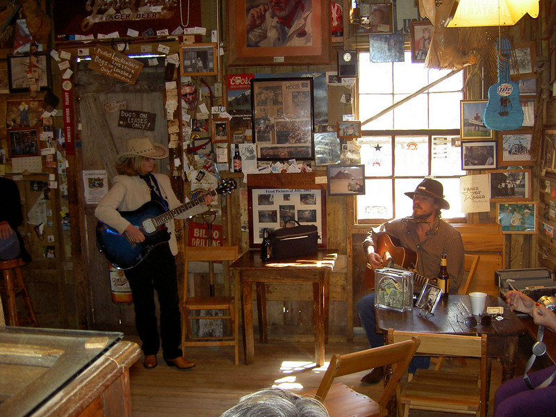 The local tourist wannabe country singer (on the left) horning in on the local talent.