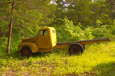 Old yellow ford truck at the entrance to Big Cedar Lodge